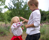 Brother and his little sister - counting out game. Children plays at counting out game royalty free stock photography