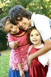 Brother holding close to his two younger sister, Stock Photo