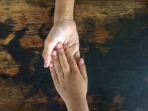Brother holding hands sister to encourage. royalty free stock photography
