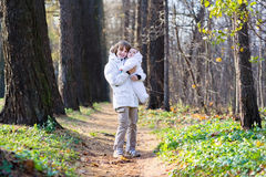 Brother holding his baby sister in the park Royalty Free Stock Photo