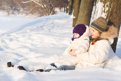 Brother holding his baby sister, playing in the snow Stock Image