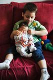 Brother holding his sister in his arms Stock Photo
