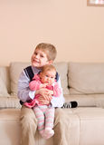 Brother holding little sister Stock Image