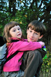 Brother holding sister Stock Images