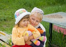 The brother holds sister. The brother has embraced sister sitting on a shop royalty free stock image