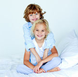 Brother hugging his sister good night Royalty Free Stock Photos