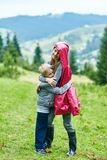 Brother hugging with sister outdoors Royalty Free Stock Image