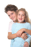 Brother hugging sister vertical Stock Images