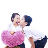 Brother kiss sister on white Stock Photography