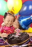 Brother kisses his sister on her birthday Stock Images