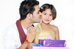 Brother kissing his cute little sister royalty free stock images