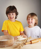 brother   knead dough together Stock Images