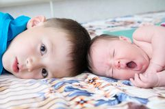 Brother and little newborn sister yawning Royalty Free Stock Images