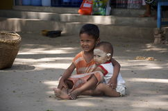 Brother looks after younger sister in Bagan Stock Photo