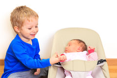 Brother playing with little sister Stock Photography