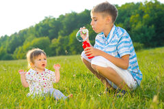 Brother plays with sister. Royalty Free Stock Images
