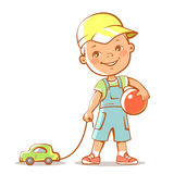 Brother. Portrait of cute little boy with car and ball. Happy child holding toys. Little brother standing. Kid wearing baseball cap, jeans shorts, t-shirt. Son Stock Photography