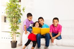 Brother reading to brothers and sister Stock Photos