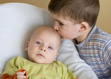 Brother's kiss. Baby and toddler portrait Stock Photography