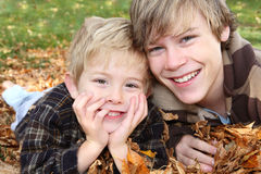 Brother's laying  in a pile of leaves Royalty Free Stock Image