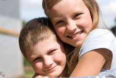 The brother and sister. On summer vacations.  A warm sunny day in village Royalty Free Stock Photo