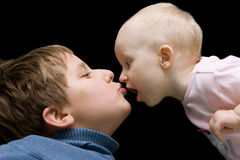 Brother and sister. Kissing each other Stock Photos