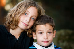 Brother and sister. Portrait of a big sister and little brother outdoors Royalty Free Stock Photo