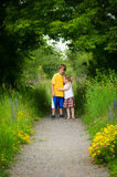 Brother and sister. Outdoors in nature on a summers day Stock Photos
