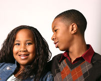 Brother and Sister. Teenage boy counsels his younger sister with white background Stock Photography