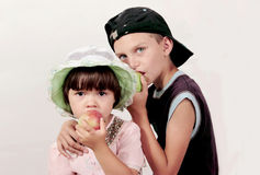 The brother and sister. The boy and the girl eat apples Stock Photo