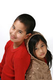 Brother and sister. Young boy and girl leaning back to back Royalty Free Stock Photo