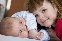 Brother and sister. Cute girl hugging her little brother, close up Stock Photo