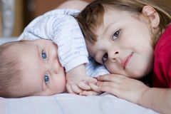 Brother and sister. Cute girl hugging her little brother, close up Stock Image