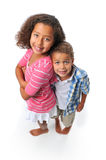 Brother and sister. Smiling isolated on white Stock Images