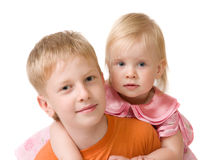 Brother and sister. Children. Sister embraces big brother Stock Images
