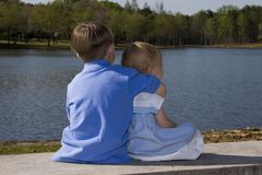 Brother and sister. Brother hugging sister stock photography