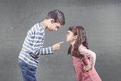 Family problems with kids fighting. Brother and sister arguing. Difficulties in family relationships Royalty Free Stock Photography