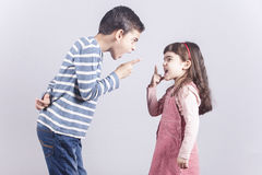 Brother and sister arguing. Brother and sister having an argument Royalty Free Stock Photography