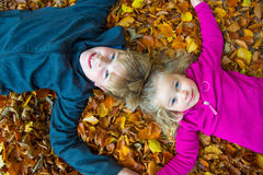 Brother and sister in autumn foliage Royalty Free Stock Photography