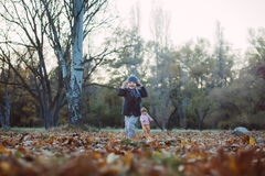 Brother and sister in the autumn park Royalty Free Stock Image