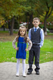 Brother and sister in autumn park Royalty Free Stock Photo