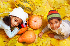 Brother and sister with autumnal harvest Stock Images
