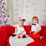Brother and sister awaiting Christmas Royalty Free Stock Photography