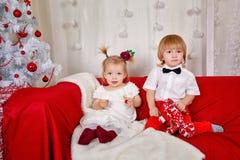 Brother and sister awaiting Christmas Royalty Free Stock Photos