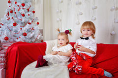 Brother and sister awaiting Christmas Royalty Free Stock Images