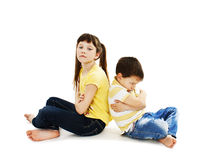 Brother and sister back to back in quarrel Royalty Free Stock Images