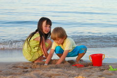 Brother and Sister on Beach Stock Photography