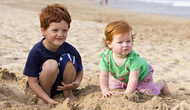 Brother and sister on the beach Royalty Free Stock Photography