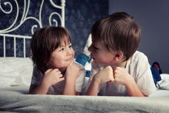 Brother and sister on bed Royalty Free Stock Photography