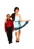 Brother and sister. A big sister in a blue dress and her little brother in dress pants and Stock Photography